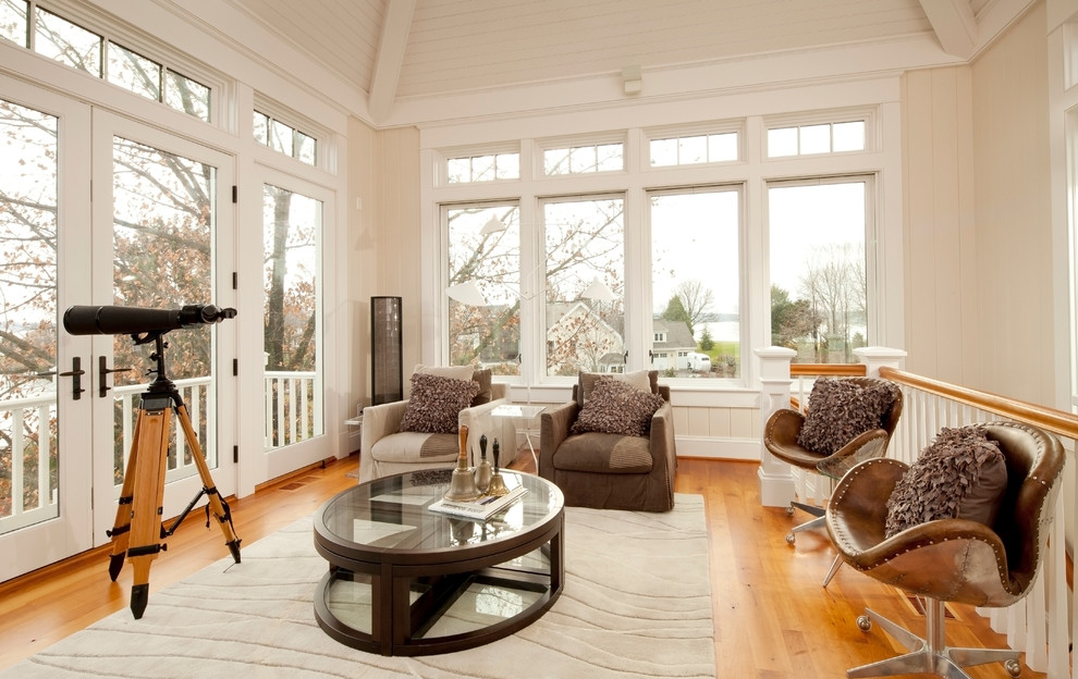 Family room - traditional family room idea in Baltimore with beige walls