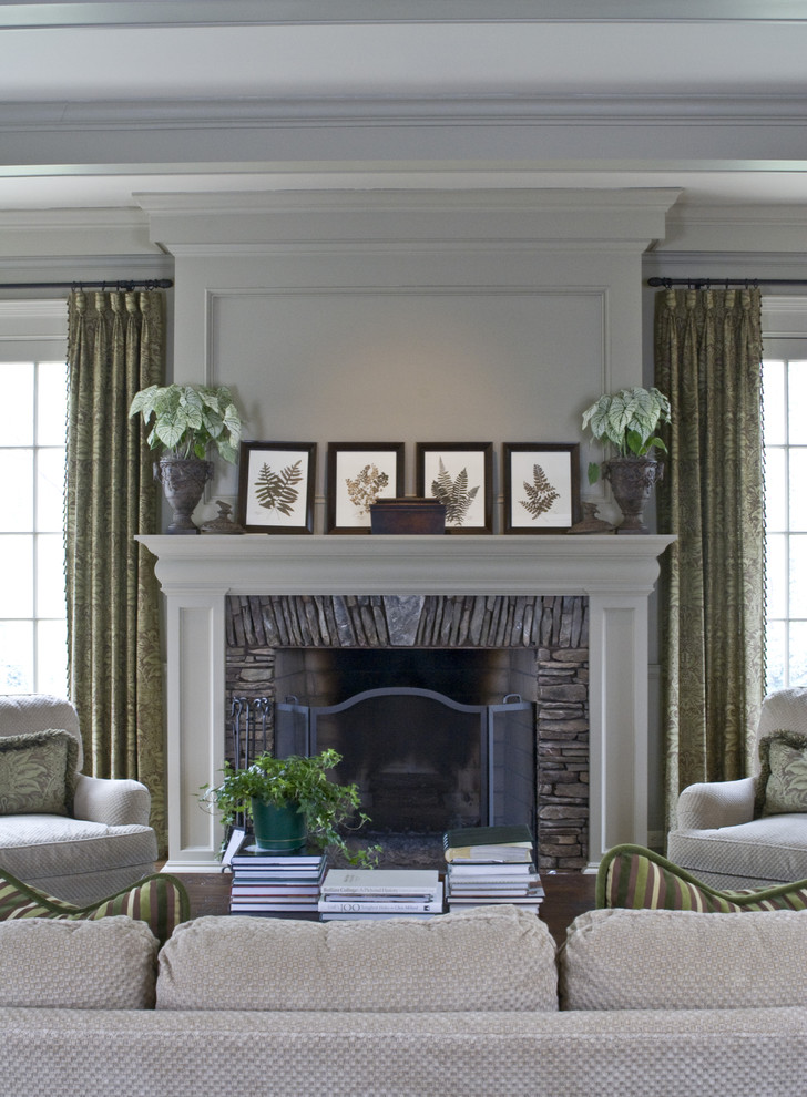 Family room - traditional family room idea in Atlanta with beige walls, a standard fireplace, a stone fireplace and no tv