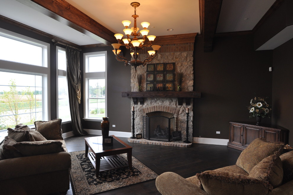 Inspiration for a large timeless open concept dark wood floor family room remodel in Chicago with a standard fireplace, a stone fireplace and black walls