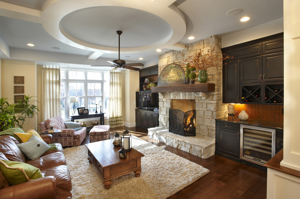 Example of a classic family room design in Chicago with a stone fireplace