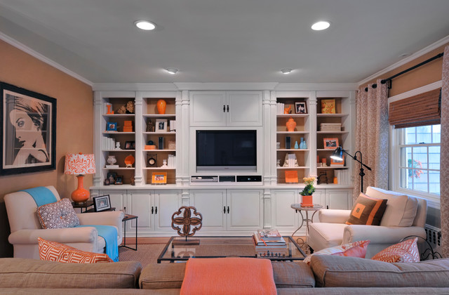 Example of a classic family room design in New York with beige walls and a media wall