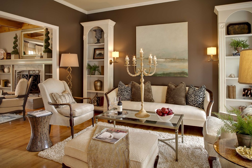 Inspiration for a timeless medium tone wood floor family room remodel in Kansas City with brown walls