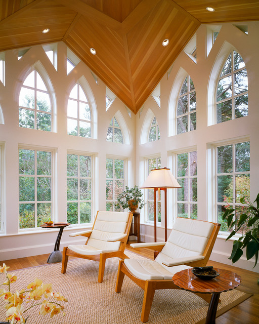 Example of a classic medium tone wood floor family room design in Boston with white walls