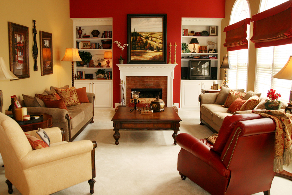 Family room - traditional carpeted and beige floor family room idea in Atlanta with red walls, a standard fireplace, a brick fireplace and a tv stand