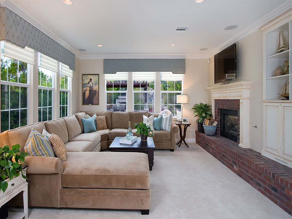 Family room - traditional family room idea in San Diego with a brick fireplace