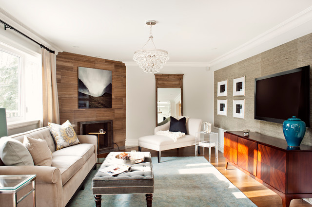 Family room - traditional family room idea in Toronto with a corner fireplace