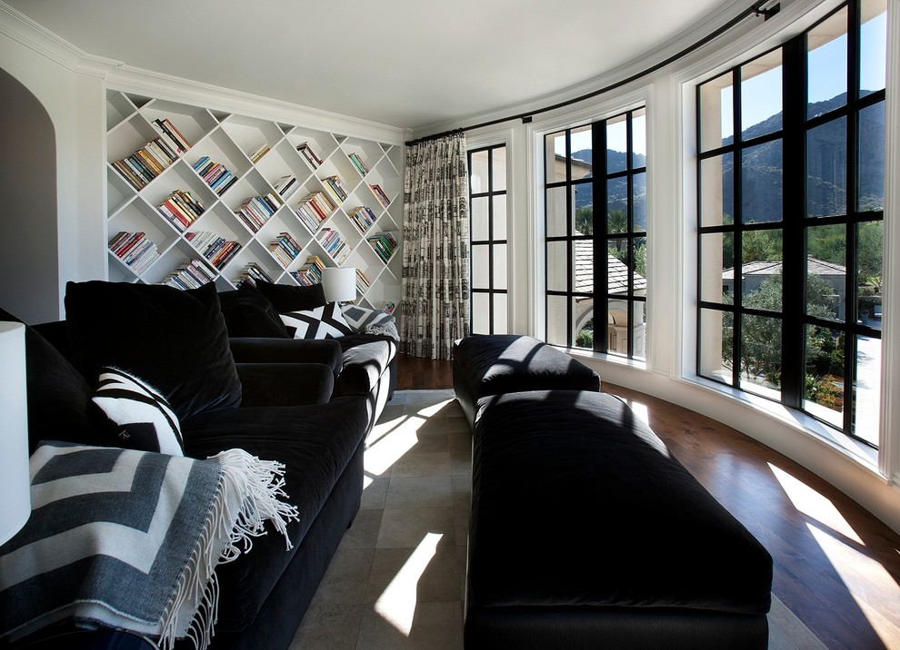 Example of a classic dark wood floor family room design in Phoenix with white walls