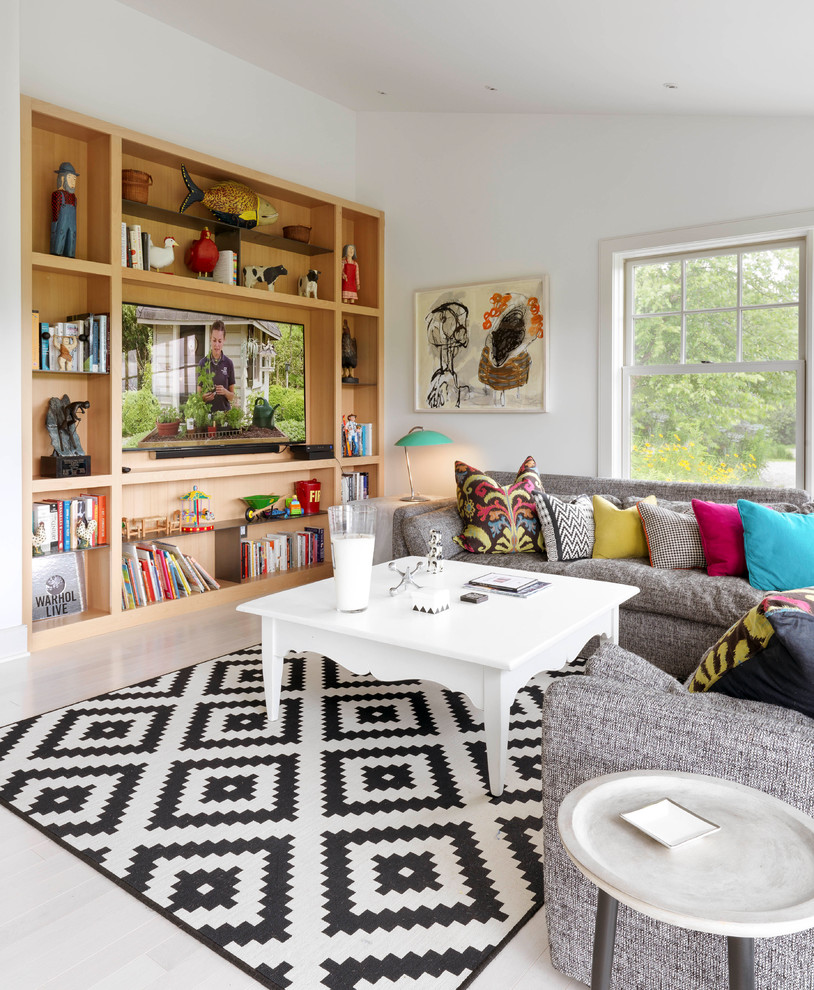 Eclectic painted wood floor and white floor family room photo in Burlington with white walls