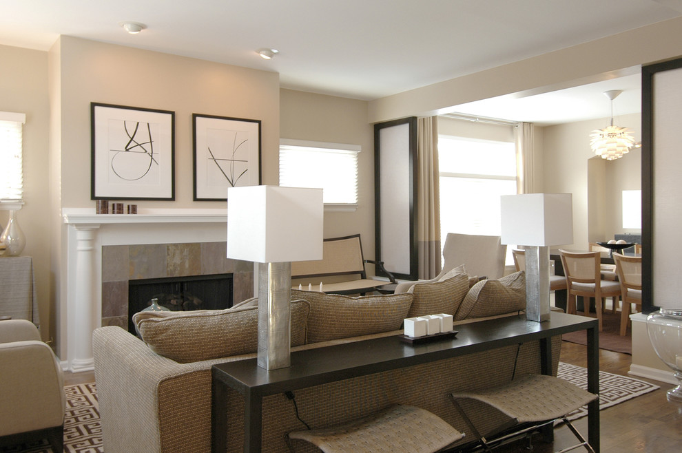 Inspiration for a mid-sized transitional open concept dark wood floor family room remodel in Boston with a tile fireplace, beige walls, a standard fireplace and no tv
