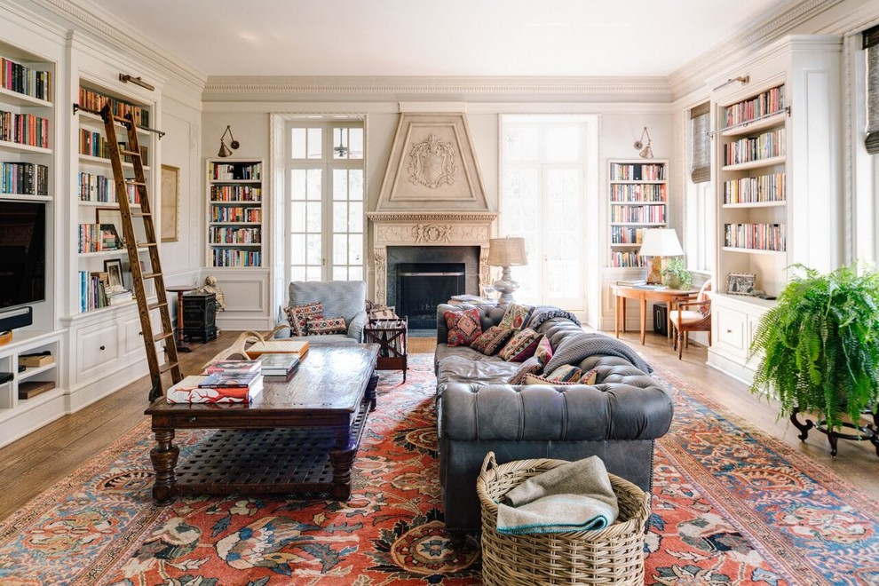 Family room library - huge transitional open concept medium tone wood floor family room library idea in Other with a standard fireplace, a tv stand, gray walls and a stone fireplace