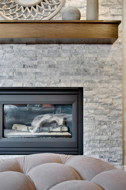 Inspiration for a small transitional enclosed dark wood floor family room remodel in Calgary with gray walls, a standard fireplace, a stone fireplace and a corner tv