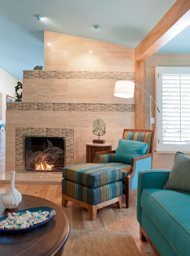 Inspiration for a tropical family room remodel in Los Angeles with a tile fireplace