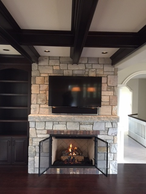 True masonry style fireplace craftsman family room for Craftsman gas fireplace