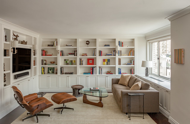 Mid-sized transitional enclosed dark wood floor and brown floor family room photo in New York with white walls, a media wall and no fireplace