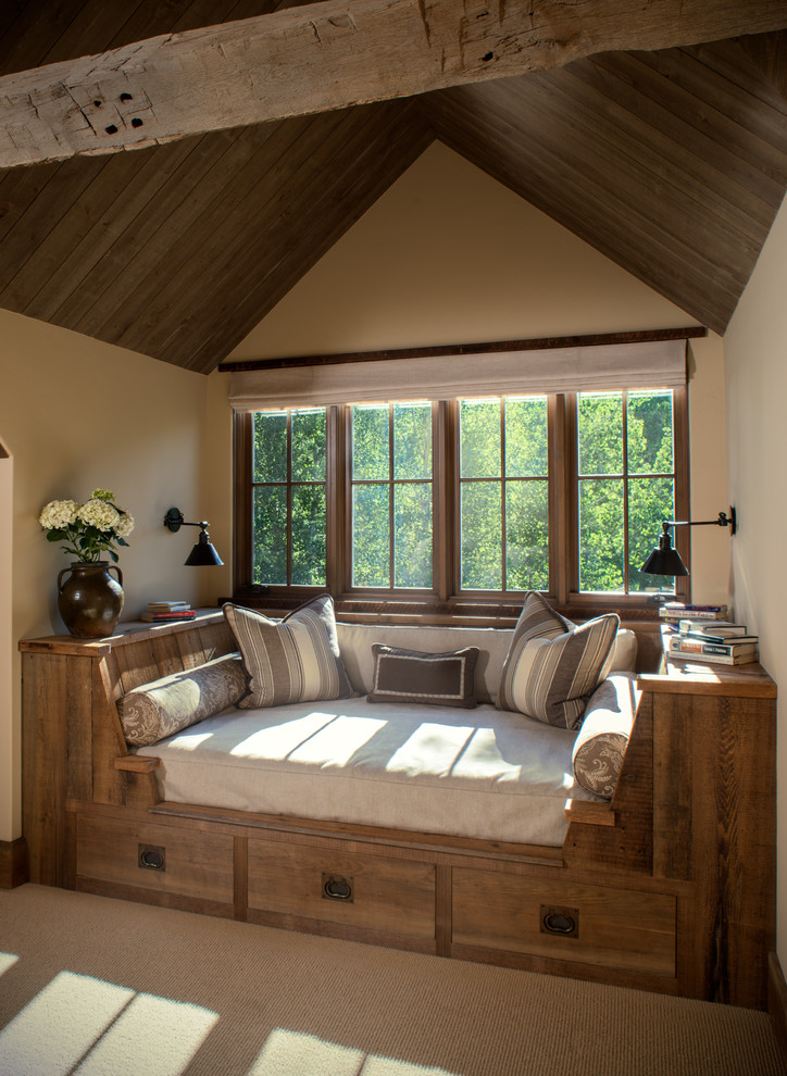 Example of a mid-sized mountain style carpeted family room design in Other with beige walls