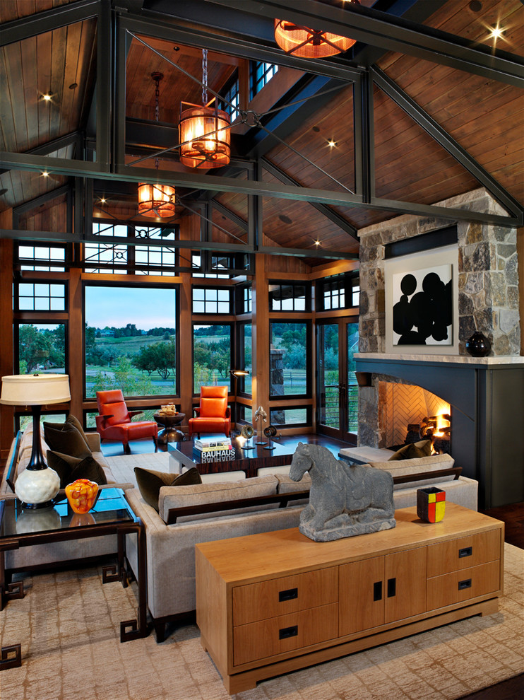Family room - contemporary open concept family room idea in Denver with a standard fireplace and a stone fireplace