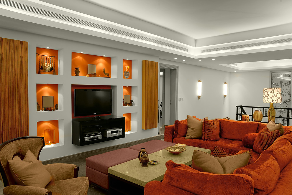 Trendy loft-style family room photo in Other with orange walls