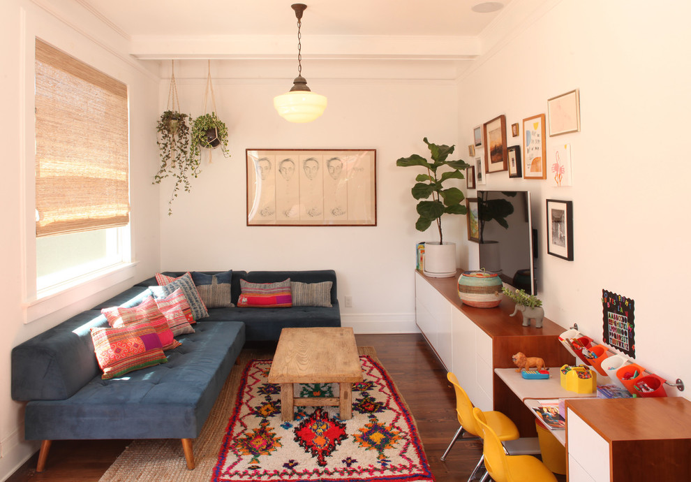 Family room - small 1950s open concept dark wood floor and brown floor family room idea in Los Angeles with white walls, a wall-mounted tv and no fireplace