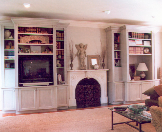 Various custom fireplace mantles, bookcases, and ...