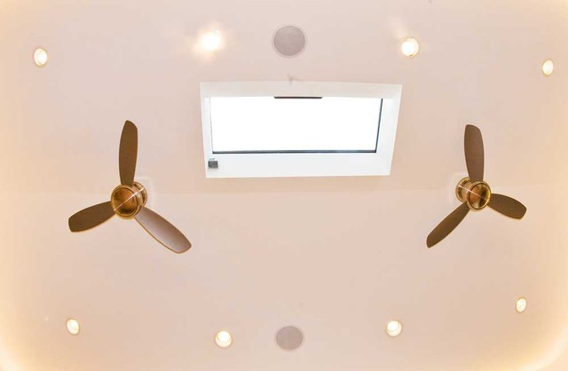 Vaulted Ceiling With Two Fans And A Skylight
