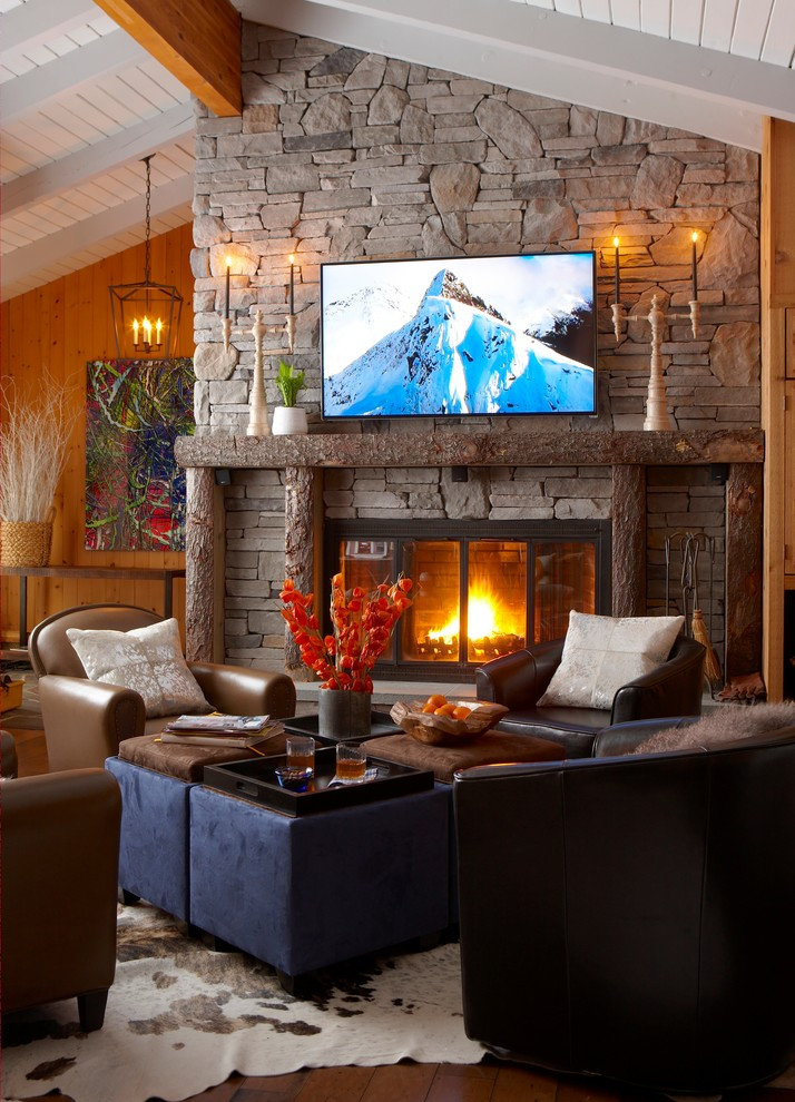 Inspiration for a mid-sized craftsman open concept medium tone wood floor and brown floor family room remodel in New York with brown walls, a standard fireplace, a stone fireplace and a wall-mounted tv