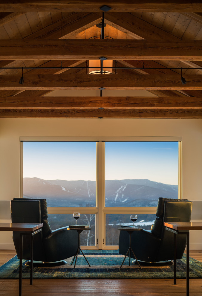 Example of a mountain style family room design in Burlington with white walls