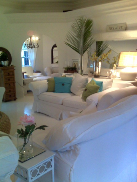 view of white wood floors different angle beach style tropical family room