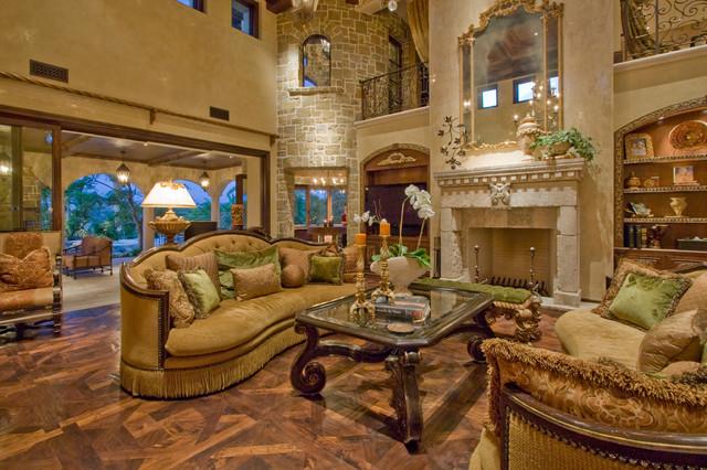 Mediterranean Open Concept Medium Tone Wood Floor Family Room Idea In Los  Angeles With Beige Walls