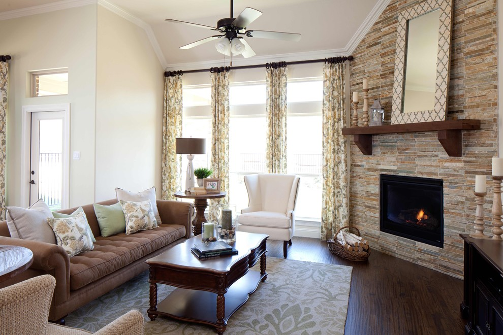 Family room - traditional dark wood floor family room idea in Dallas with beige walls, a corner fireplace and a stone fireplace
