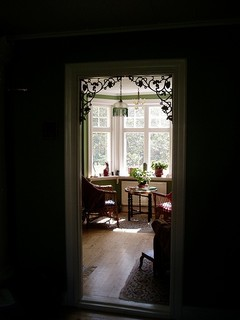 in this example iron accents use brackets to decorate a doorway beautiful silhouetted