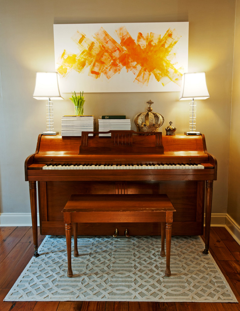 Example of a transitional family room design in New Orleans