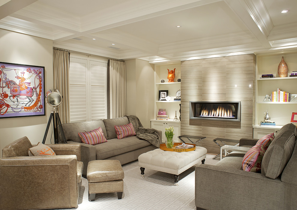 Example of a transitional carpeted family room design in Toronto with beige walls, a ribbon fireplace and no tv