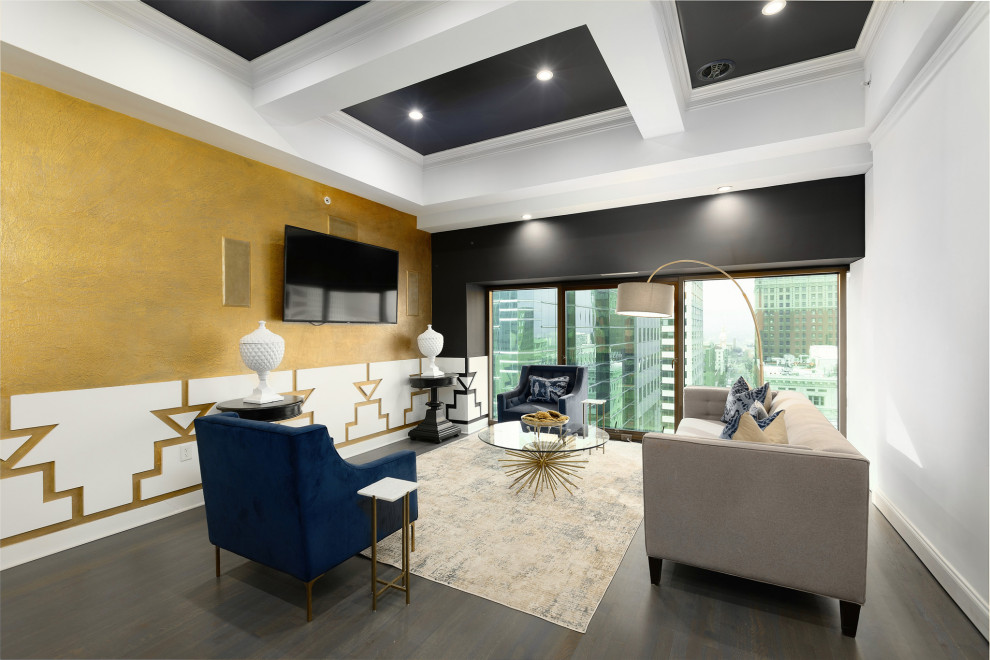 Example of a transitional open concept dark wood floor and coffered ceiling family room design in Kansas City with multicolored walls, no fireplace and a wall-mounted tv