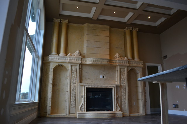 Wall unit with fireplace insert mediterranean-family-room