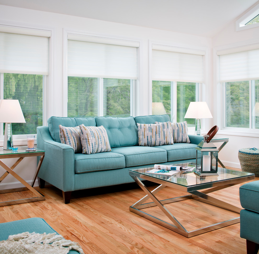 Inspiration for a contemporary medium tone wood floor family room remodel in Boston with white walls
