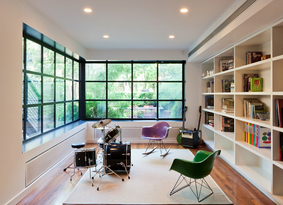 Family room - modern family room idea in New York with a music area
