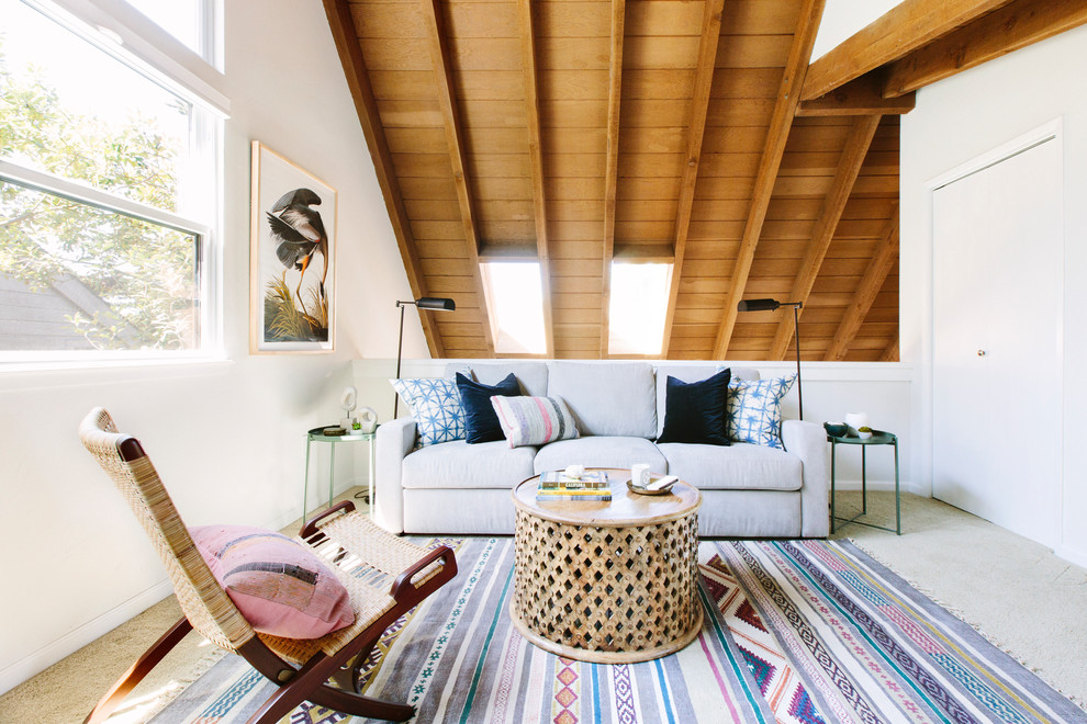 Example of a beach style carpeted and beige floor family room design in San Francisco with white walls
