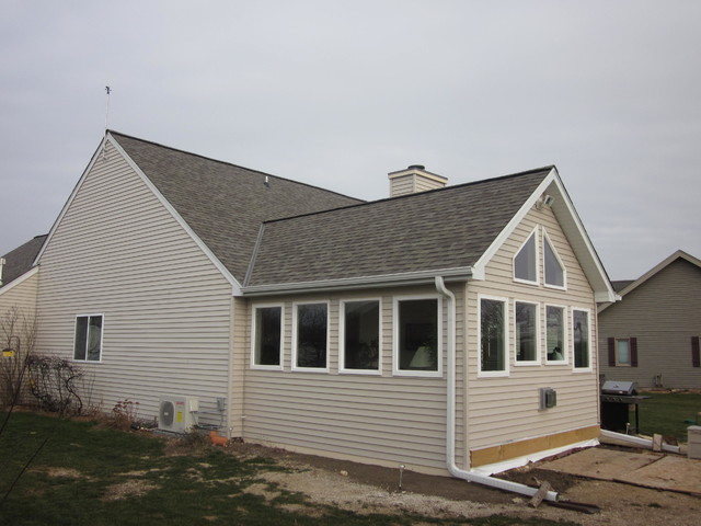 Waukesha four season sunroom addition for Adding sunroom to ranch house