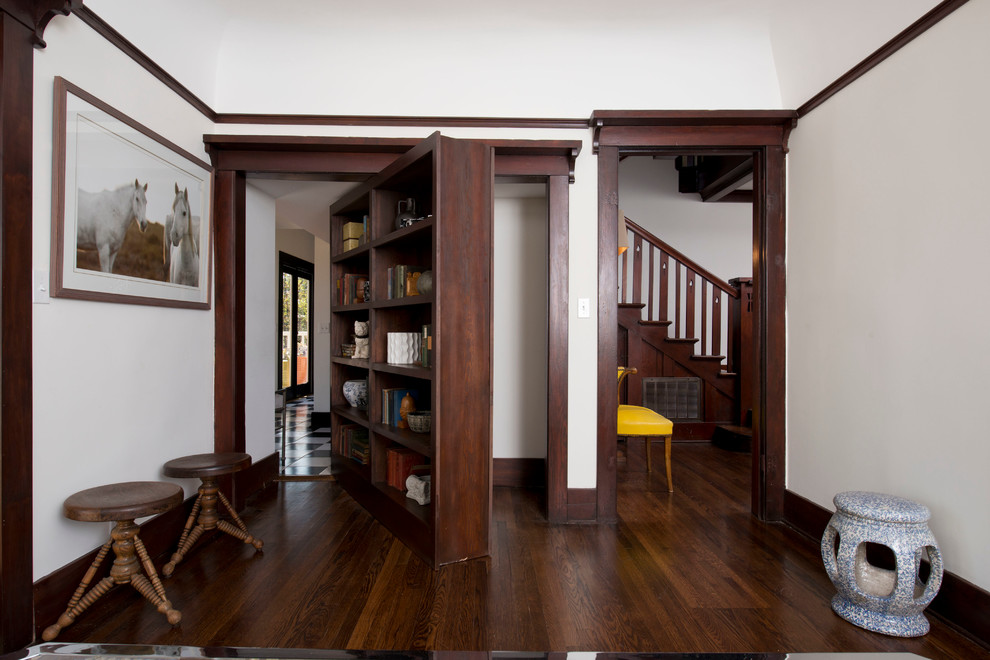 Example of a large arts and crafts open concept dark wood floor family room library design in Los Angeles with no tv, white walls and no fireplace