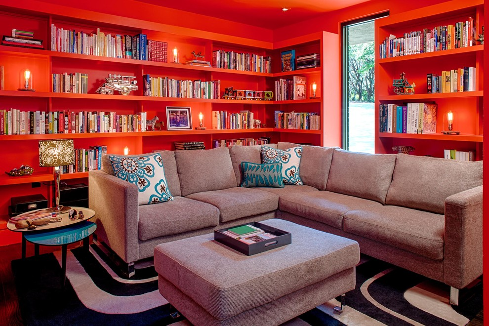 Inspiration for a contemporary family room library remodel in Austin with red walls