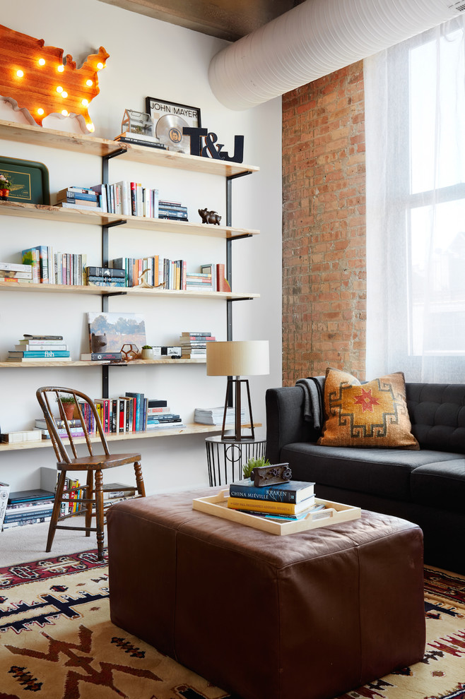 Family room library - contemporary family room library idea in Chicago with white walls