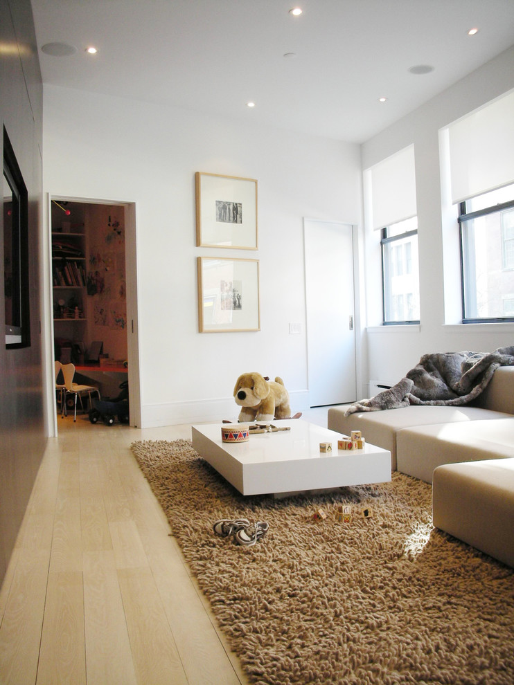 Danish family room photo in New York with white walls and a media wall