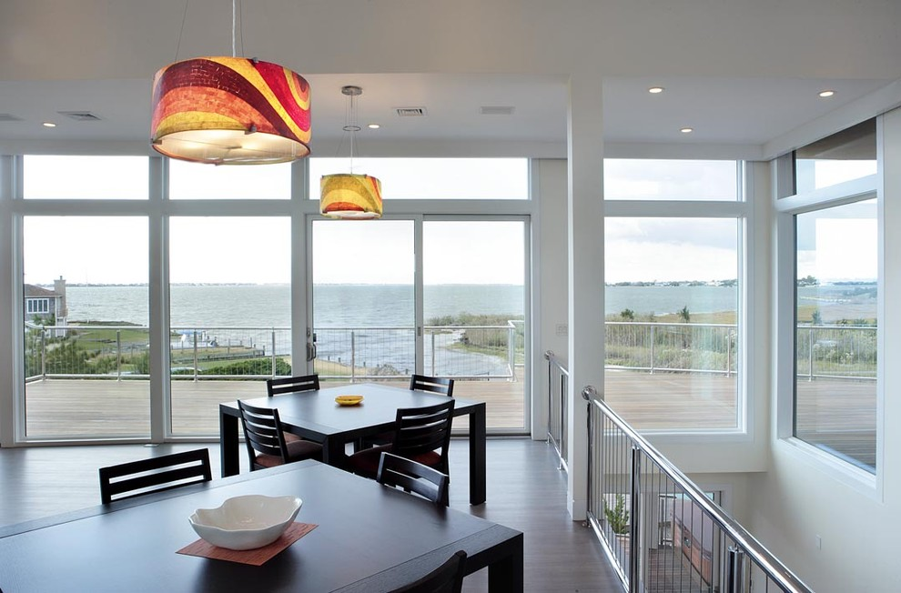 Inspiration for a contemporary open concept family room remodel in New York with white walls