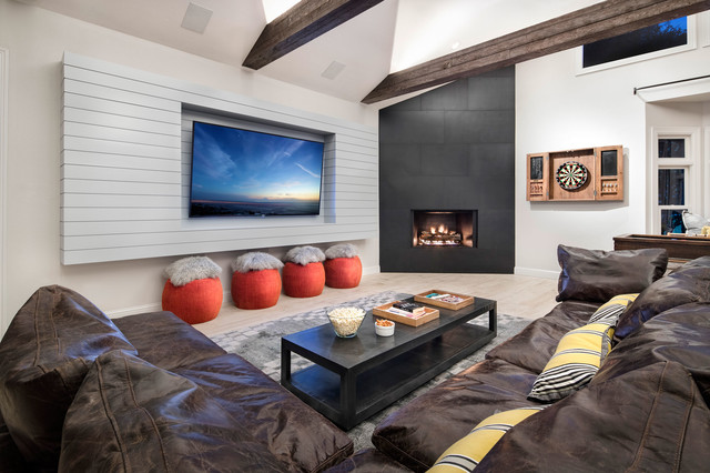Inspiration for a large contemporary open concept porcelain floor and beige floor family room remodel in Austin with a bar, gray walls, a metal fireplace and a media wall
