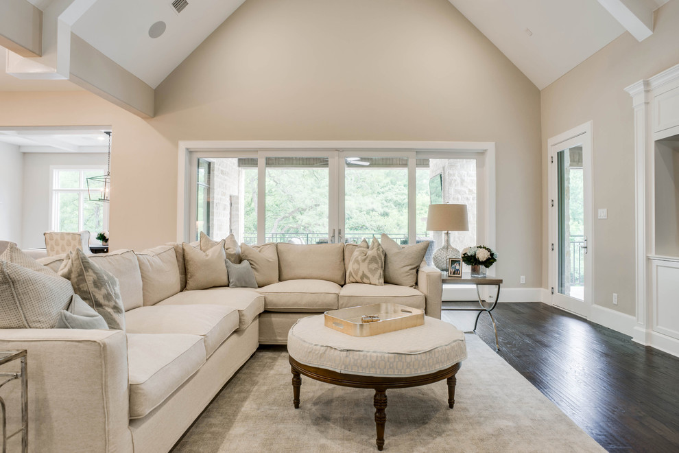 Large transitional open concept medium tone wood floor and brown floor family room photo in Dallas with gray walls and a standard fireplace