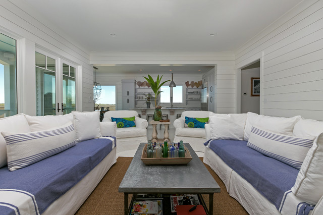 White House Family Room With Blue Couches Wood Walls