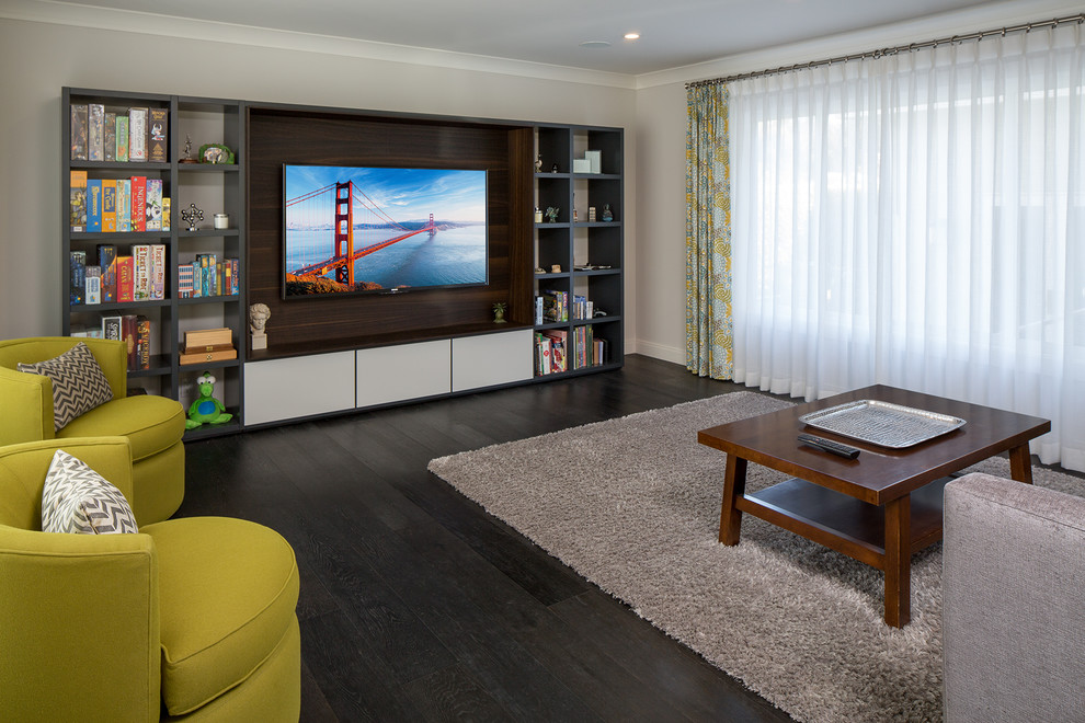 Mid-sized trendy open concept dark wood floor and black floor family room photo in Los Angeles with a media wall, gray walls and no fireplace