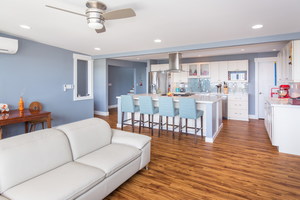 Large transitional open concept light wood floor family room photo in Hawaii with blue walls, no fireplace and a tv stand