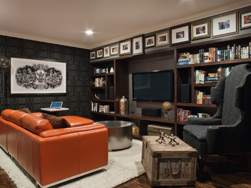 Mid-sized transitional enclosed dark wood floor and brown floor family room photo in San Francisco with black walls and a wall-mounted tv