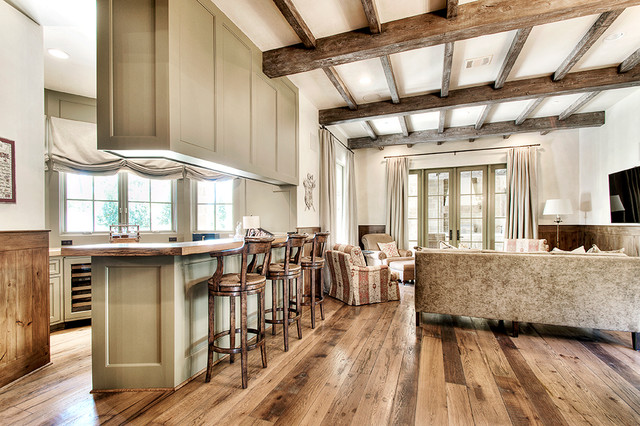 Inspiration for a timeless open concept medium tone wood floor and brown floor family room remodel in Houston with white walls and a wall-mounted tv